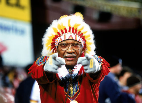 "WASHINGTON, D.C. - DECEMBER 27: Washington Redskins fan ""Chief Zee"" watches the game against the Philadelphia Eagles on December 27, 2003 at FedEx Field in Washington, D.C. (Photo by Jerry Driendl/Getty Images)"