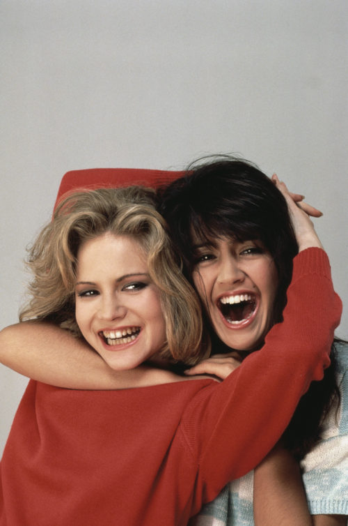 ca. August 1983 --- Actresses Jennifer Jason Leigh (left) and Phoebe Cates played the unforgettable roles of Stacy Hamilton and Linda Barrett, respectively, in the 1982 classic . --- Image by © Douglas Kirkland/CORBIS