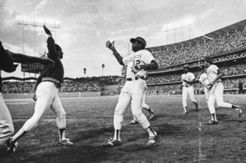 this was the 'first' high five EVER between Dodgers Glenn Burke and Dusty Baker on October 2, 1977