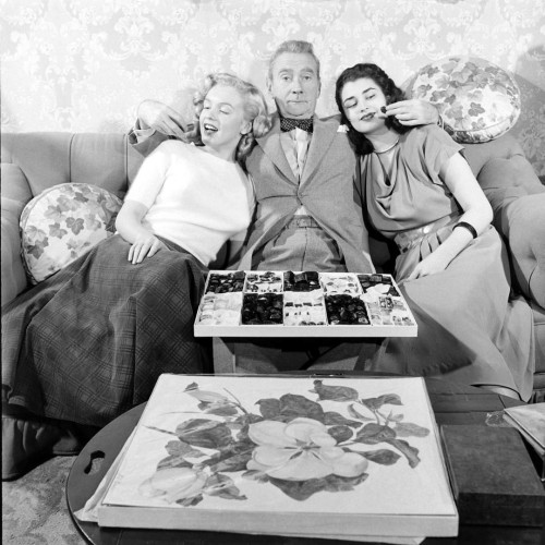 "Clifton Webb as a baby-sitter indulging with two women in scene from film ""Sitting Pretty."""